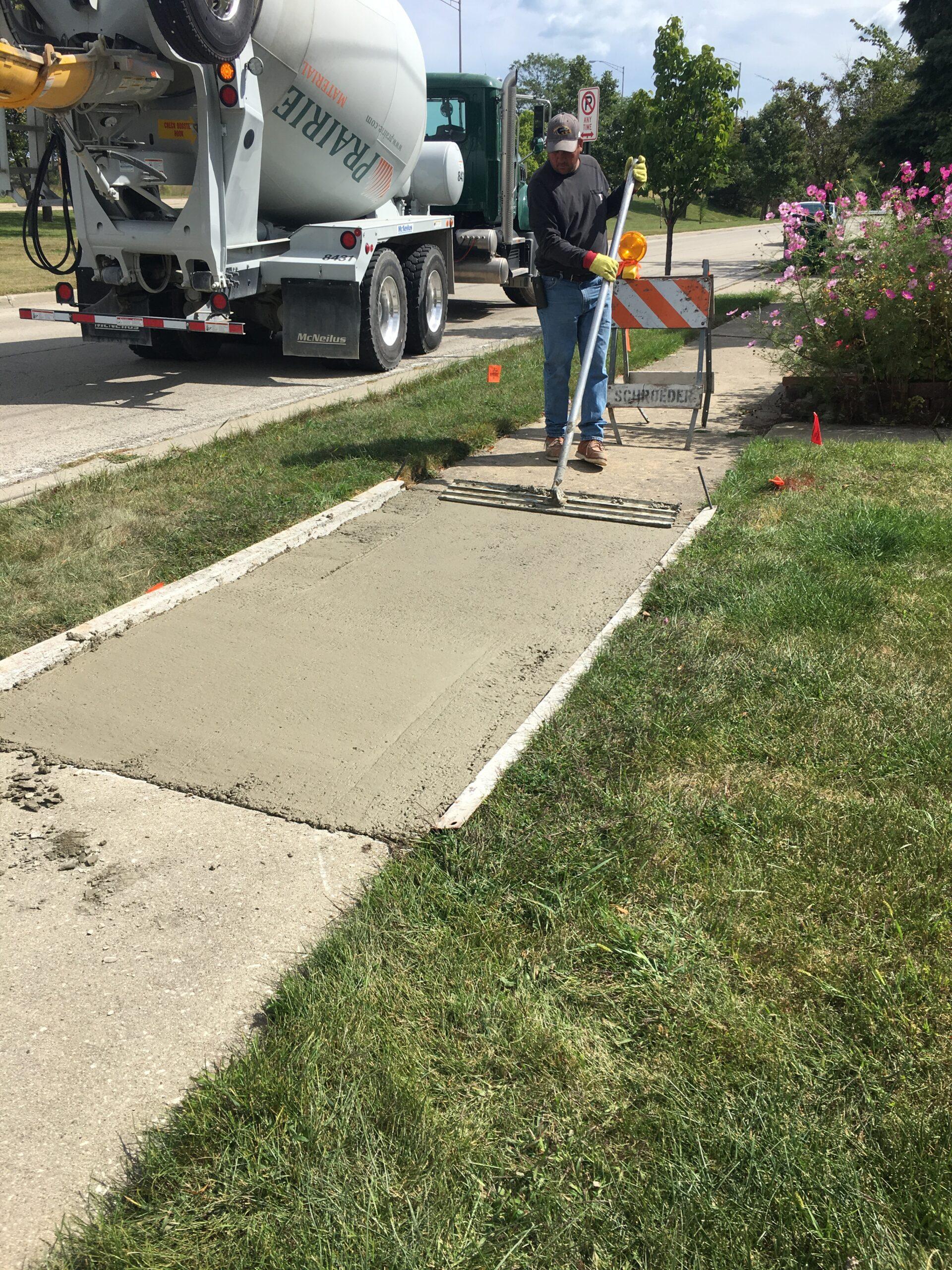 Finishing New Sidewalk Squares